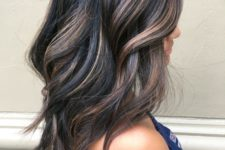 13 give your black hair dimension with brown and caramel balayage