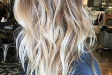 13 light wavy layered bronde hair with blonde balayage for a highlight