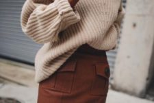 14 a creamy oversized sweater and a mini brown skirt with pockets and buttons