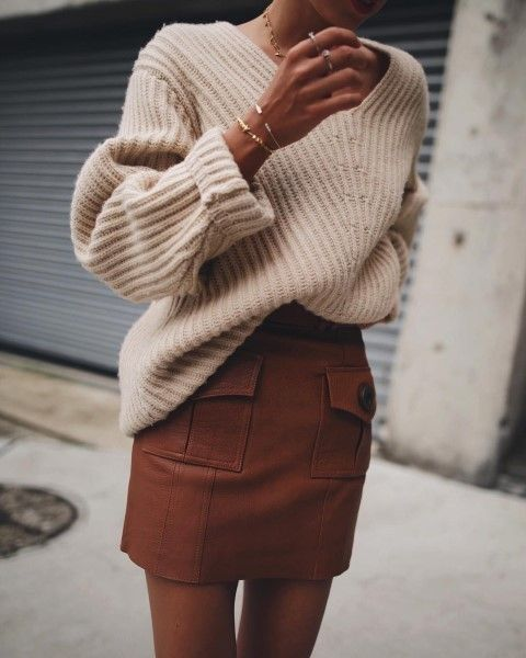 a creamy oversized sweater and a mini brown skirt with pockets and buttons
