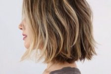14 a wavy short brown bob with blonde balayage highlights for creating a volume