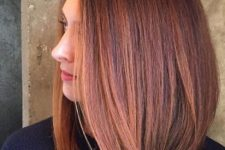 14 bold red hair with rose gold highlights on medium length hair