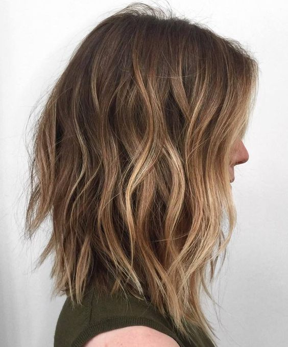 long choppy brown bob with blonde balayage for a highlight