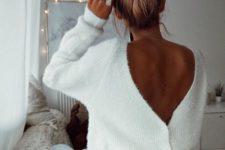 15 a messy voluminous top knot is a great to rock with a turtleneck or a scarf