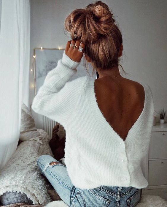 a messy voluminous top knot is a great to rock with a turtleneck or a scarf