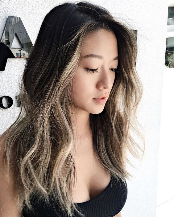 black hair with face-framing bronde balayage is a bold statement