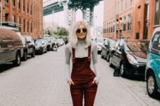 15 black suede sock boots, a grey turtleneck and a burgundy velvet overall for a stylish look
