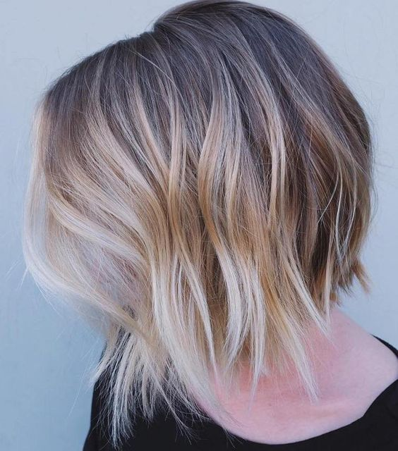 brown bob haircut with an uneven edge and blond balayage for a mind blowing look
