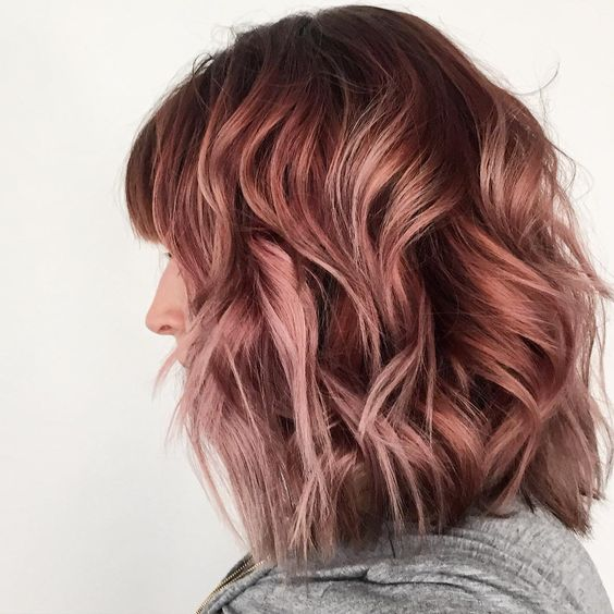 dark brunette hair with lots of rose gold highlights for a soft and eye catchy look