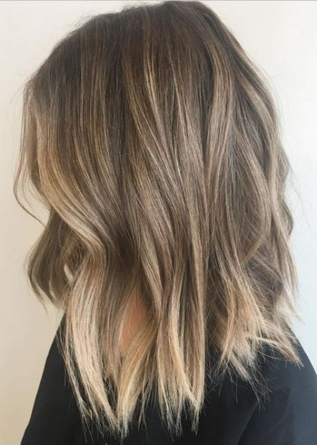 perfectly bronded balayage on wavy shoulder-length hair looks casual yet interesting