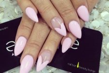 15 pink nails with an accent heart-shaped nail on sharp nails