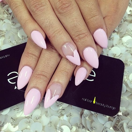 pink nails with an accent heart shaped nail on sharp nails