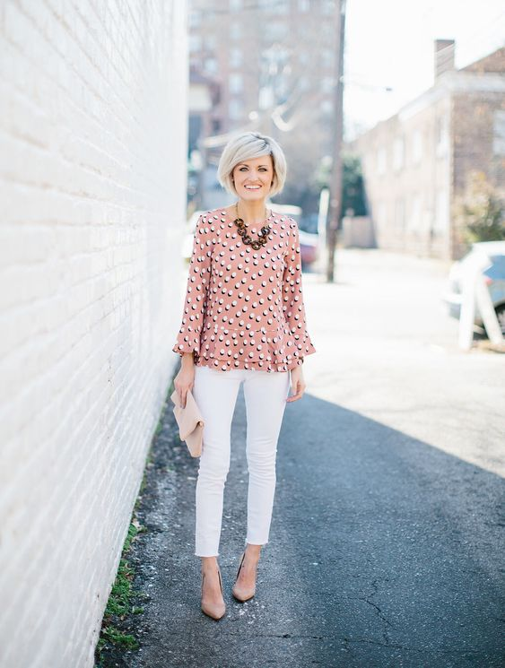 white jeans, a pretty pink peplum top, nude heels and a clutch