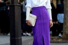 15 yellow boots, an ultraviolet midi skirt with a slit, a white shirt and a sweater