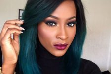 16 a black roots with teal ombre for a very contrasting look