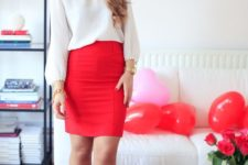 16 a white shirt with a pompom trim, a red skirt, grey heels for a cute casual look