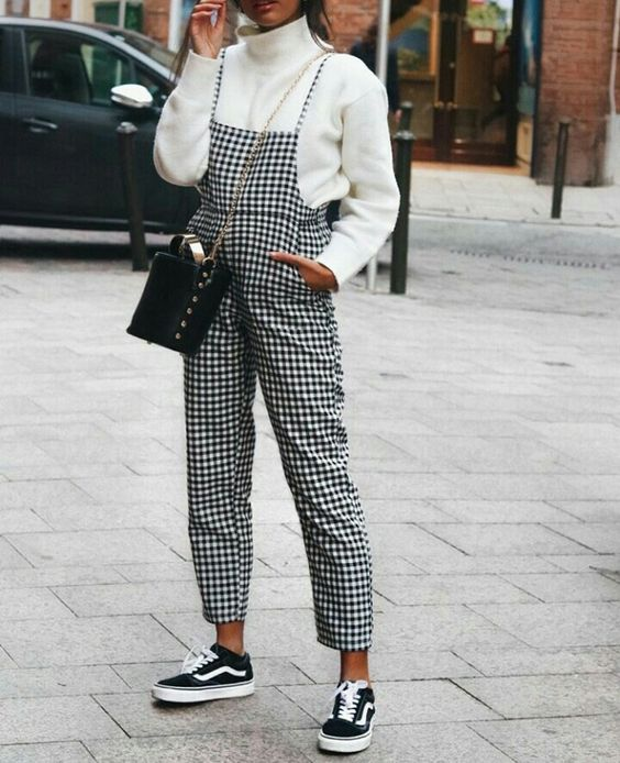 black Vans, a white sweater, a checked cropped overall and a bag