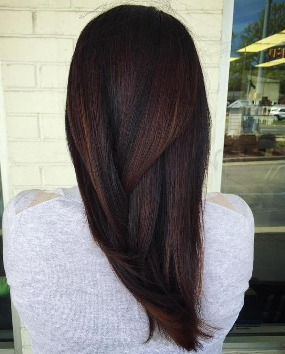 black hair with plum colored and caramel balayage looks jaw dropping