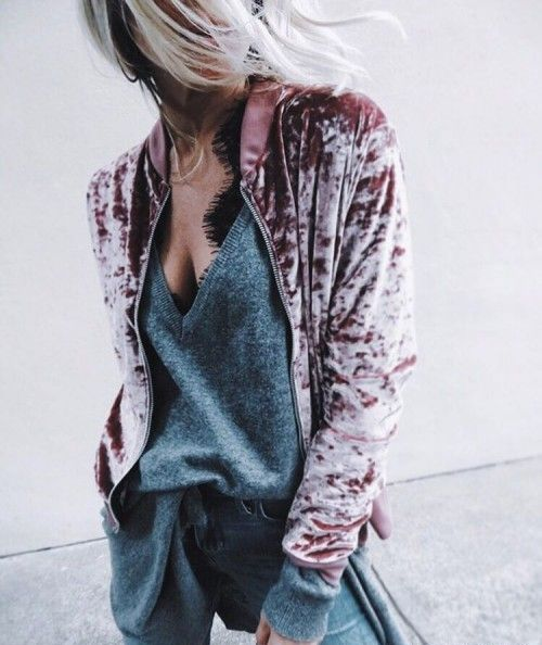 blue jeans, a black lace top, a grey cashmere sweater and a pink crushed velvet jacket