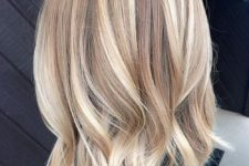 16 wavy bronde hair with lots of blonde balayage to look bold and cool