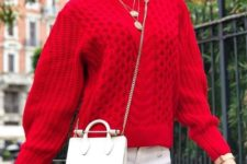 16 white jeans, a red sweater, layered necklaces and a small crossbody bag
