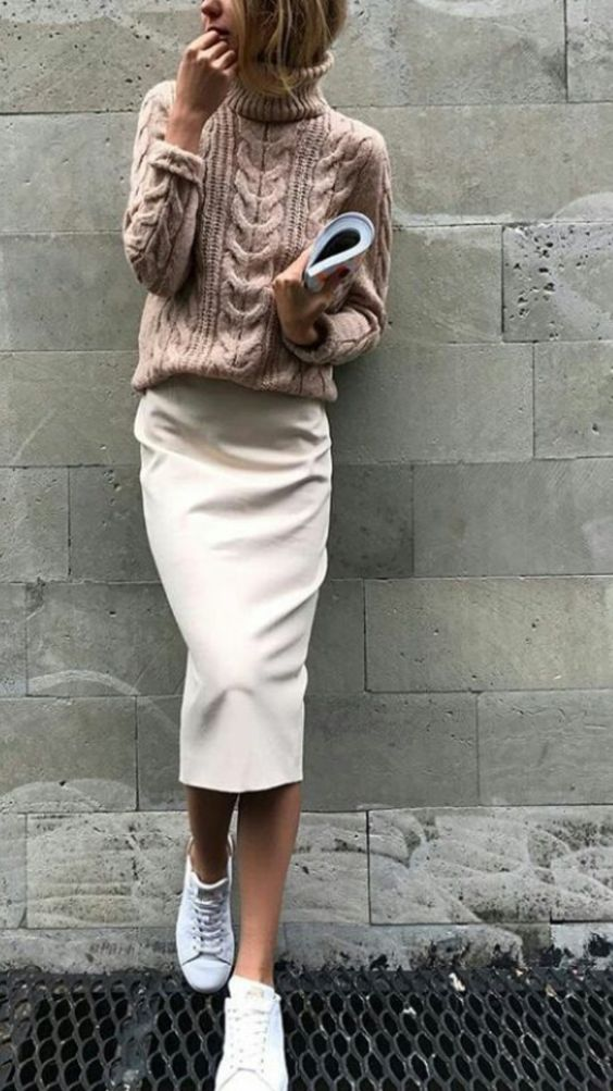 white sneakers, a blush sweater, a creamy midi skirt