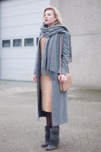 With beige midi dress, gray coat, gray fringe mid calf boots and beige bag