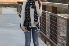 With beige shirt, distressed jeans, black pumps and clutch