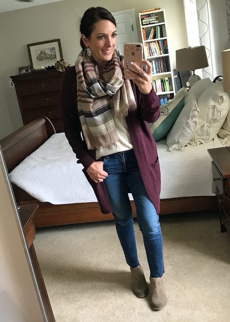 With beige shirt, jeans, suede boots and marsala cardigan