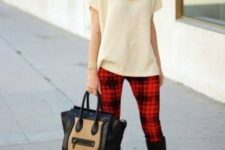 With beige sweater, high boots and two color bag