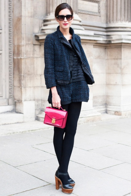 With black blouse, tweed jacket, pink bag and platform shoes