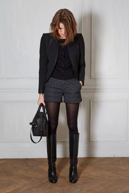 With black button down shirt, black blazer, high boots and small bag