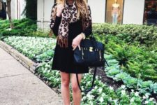 With black dress, black bag and camel boots