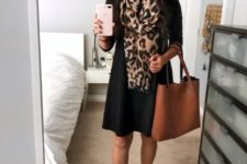 With black dress, brown tote and brown suede boots
