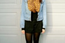 With black dress, denim jacket, high boots and black tights