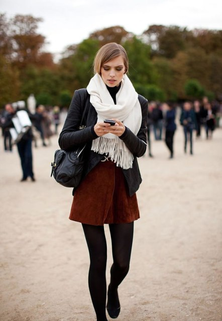 With black jacket, mini skirt and black bag
