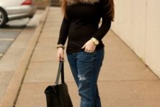 With black shirt, distressed jeans, pumps and bag