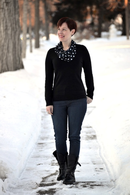With black shirt, jeans and mid calf boots
