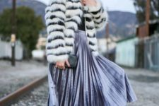 With black shirt, pleated midi skirt, heels and clutch