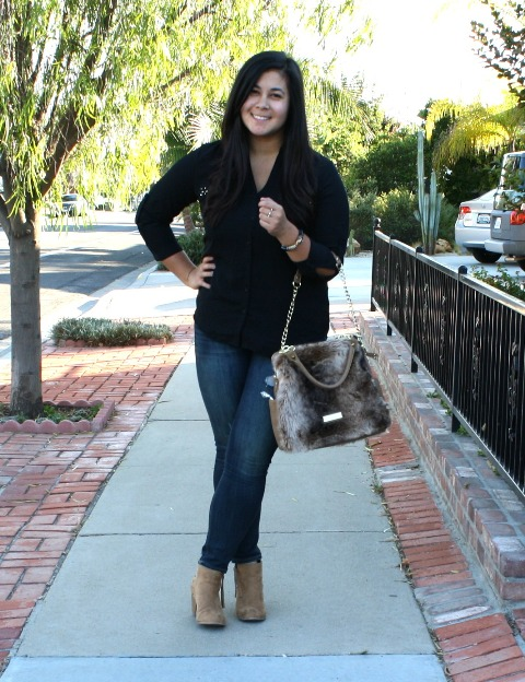 With black shirt, skinny jeans and beige suede boots
