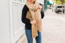 With black shirt, skinny jeans, heels and leopard clutch