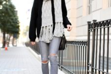With black sweater, gray distressed jeans, black pumps and black bag