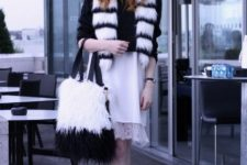 With black sweater, white skirt, flat shoes and fur scarf