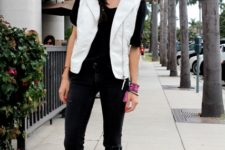With black t-shirt, black pants, cutout boots and sunglasses