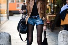 With black t-shirt, brown leather jacket, black boots and black bag