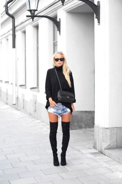 With black turtleneck sweater, chain strap bag and over the knee boots