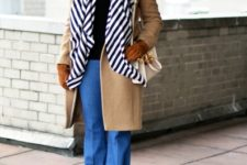 With black turtleneck, wide-leg jeans, camel coat and white bag