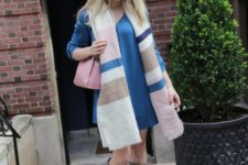 With blue dress, gray suede boots and pink bag
