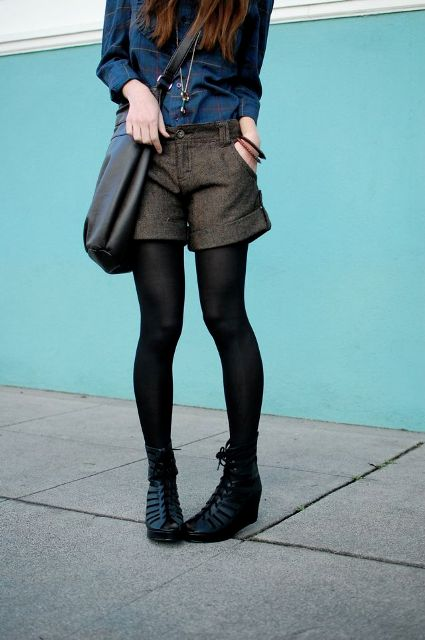 With blue shirt, lace up boots and crossbody bag