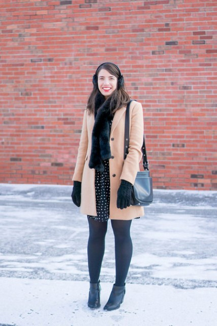 With camel coat, polka dot dress, blue tights and ankle boots